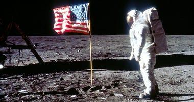 Apollo 11 Astronaut Buzz Aldrin Poses next To The U.S. flag On Moon