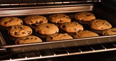 A dozen cookies baking in the oven