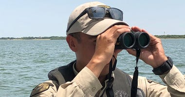 Lewisville Lake/Denton County game warden Josh Espinoza looks for boating safety problems on Lewisville Lake
