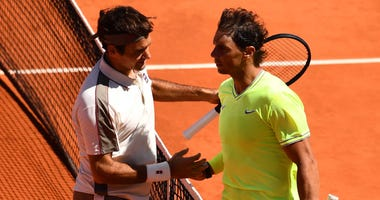 Rafael Nadal of Spain and Roger Federer of Switzerland embrace after their semifinal match at the 2019 French Open.