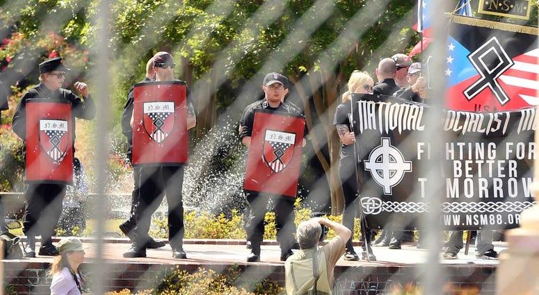Neo-Nazis protest behind barricades