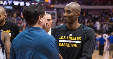 Los Angeles Lakers guard Kobe Bryant (24) greets Dallas Mavericks owner Mark Cuban