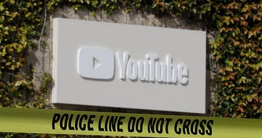 Police tape is shown outside of a YouTube office building in San Bruno, Calif.,