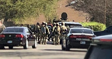 FBI agents raid the home of the Austin bombing suspect