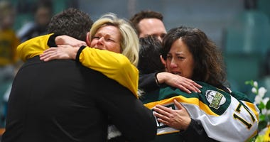 Canadian Prime Minister Justin Trudeau attends a vigil at the Elgar Petersen Arena, home of the Humboldt Broncos, to honor the victims of Friday's fatal bus accident, in Humboldt, Saskatchewan, Sunday, April 8, 2018.