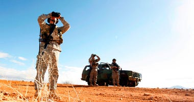 ILE - In this Friday, Jan. 19, 2007 file photo, a National Guard unit patrols the Arizona-Mexico border in Sasabe, Ariz. On Friday, April 6, 2018