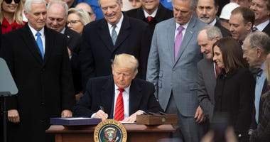 U.S. President Donald Trump signs the United States-Mexico-Canada Agreement