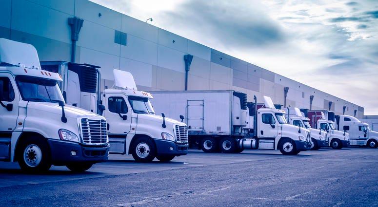 Trucks loading unloading at warehouse