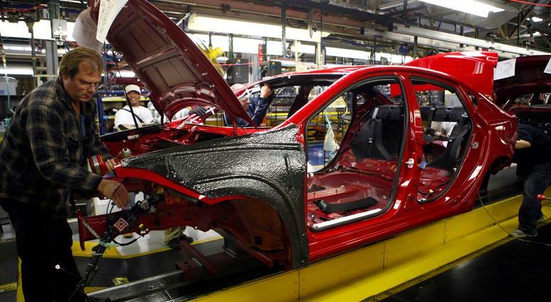Workers assemble a preproduction Dodge Dart