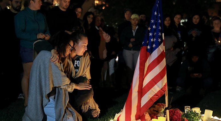 People attend the memorial to mourn the victims of the mass shooting in Thousand Oaks, California,