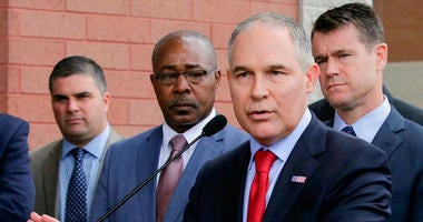 """FILE - In this April 19, 2017, file photo, Environmental Protection Agency Administrator Scott Pruitt speaks at a news conference with Pasquale """"Nino"""" Perrotta, second from left, in East Chicago, Ind."""