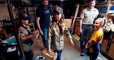 "FILE - In this March 1, 2018, file photo, Tatum Weir, center, carries a tool box she built as her twin brother Ian, left, follows after a Cub Scout meeting in Madbury, N.H. Fifteen communities in New Hampshire are part of an ""early adopter"" program to all"