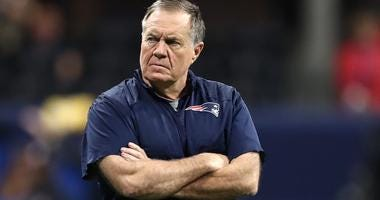 New England Patriots coach Bill Belichick walks on the field before Super Bowl LIII.