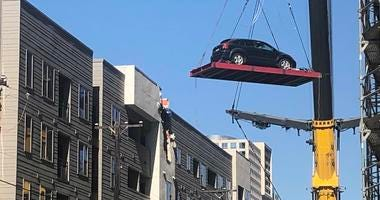Cranes Remove Cars From Dallas Apartment Complex