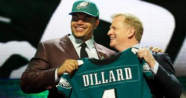 Philadelphia Eagles rookie Andre Dillard poses with NFL commissioner Roger Goodell at the 2019 NFL Draft.