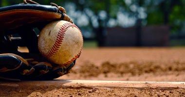Baseball in glove on team field