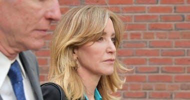 Felicity Huffman exits the John Joseph Moakley U.S. Courthouse after appearing in Federal Court to answer charges stemming from college admissions scandal on April 3, 2019 in Boston, Massachusetts