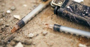 Used syringe on the ground
