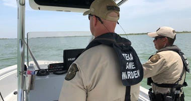LLewisville Lake/Denton County Game Wardens Jerry Norris (left) and Josh Espinoza patrolling Lewisville Lake