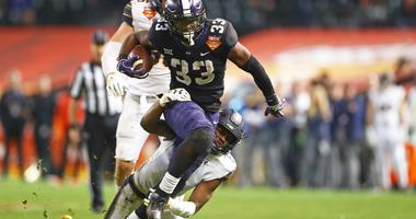 Dec 26, 2018; Phoenix, AZ, USA; Texas Christian Horned Frogs running back Sewo Olonilua (33) is tackled by California Golden Bears safety Jaylinn Hawkins (6) in the 2018 Cheez-It Bowl at Chase Field.