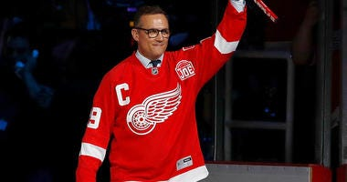 Steve Yzerman waves to the crowd at a Detroit Red Wings ceremony in 2017.
