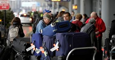 Passengers moving luggage at an airport