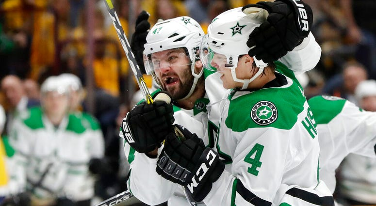 Dallas Stars right wing Alexander Radulov (47) celebrates with defenseman Miro Heiskanen (4)