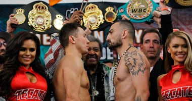 Gennady Golovkin, left, faces off with Vanes Martirosyan during a weigh-in Friday, May 4, 2018, in Los Angeles. Golovkin will defend his middleweight title against Martirosyan in a boxing match Saturday at StubHub Center in Carson, Calif.