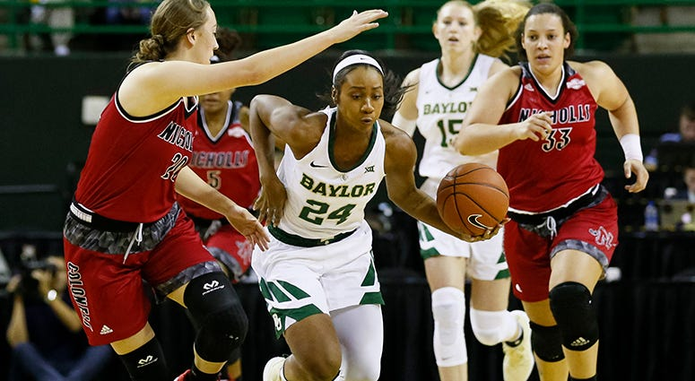Baylor guard Chloe Jackson (24) drives past Nicholls State guard Cassidy Barrios, left, in the first half of an NCAA college basketball game on Tuesday, Nov. 6, 2018
