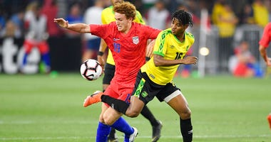 U.S. forward Josh Sargent (19) battles for the ball against Jamaica midfielder Peter Vassell (16) during the second half of an international friendly soccer match
