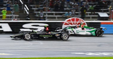 Josef Newgarden (2) leads Alexander Rossi (27) during the IndyCar auto race at Texas Motor Speedway, Saturday, June 8, 2019, in Fort Worth, Texas.