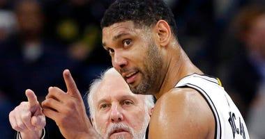 San Antonio Spurs head coach Gregg Popovich, talks with Tim Duncan