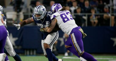 Dallas Cowboys defensive lineman Michael Bennett (79) rushes as Minnesota Vikings tight end Tyler Conklin (83) blocks during the second half of an NFL football game in Arlington, Texas, Sunday, Nov. 10, 2019.