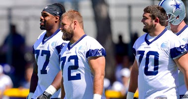 Dallas Cowboys offensive tackle Tyron Smith (77), center Travis Frederick (72) and guard Zack Martin (70)