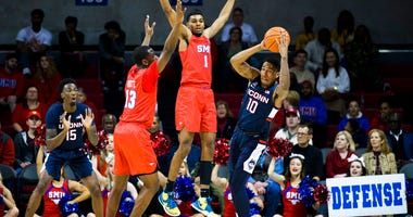 SMU forward Feron Hunt (1) and guard CJ White (13) defend against Connecticut guard Brendan Adams (10) during the first half of an NCAA college basketball game Wednesday, Feb. 12, 2020, in Dallas.