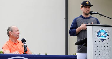 Houston Astros' Alex Bregman, right, delivers a statement as Astros owner Jim Crane listens