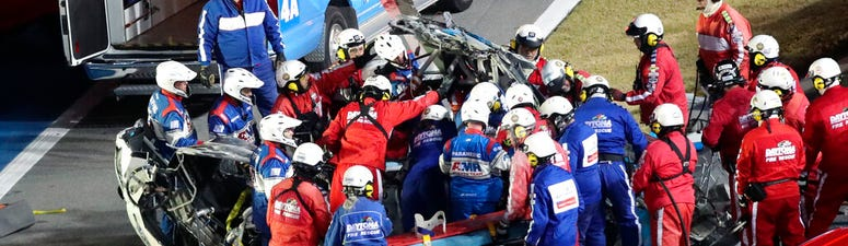 Rescue workers remove Ryan Newman from his car after he was involved in a wreck on the last lap of the NASCAR Daytona 500
