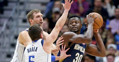 Dec 28, 2018; New Orleans, LA, USA; New Orleans Pelicans forward Julius Randle (30) is double teamed by Dallas Mavericks forward Dirk Nowitzki (41) and guard J.J. Barea (5) in the second quarter at the Smoothie King Center.