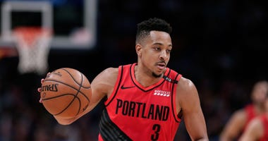 May 1, 2019; Denver, CO, USA; Portland Trail Blazers guard CJ McCollum (3) dribbles the ball in the second quarter against the Denver Nuggets in game two of the second round of the 2019 NBA Playoffs at the Pepsi Center.