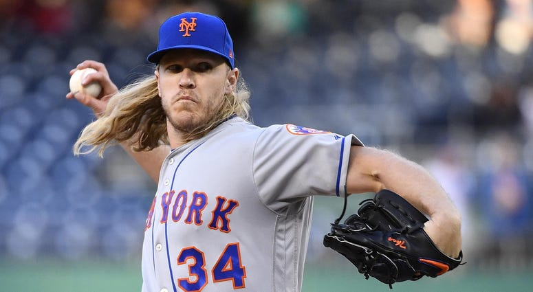 May 14, 2019; Washington, DC, USA; New York Mets starting pitcher Noah Syndergaard (34) throws against the Washington Nationals during the first inning at Nationals Park