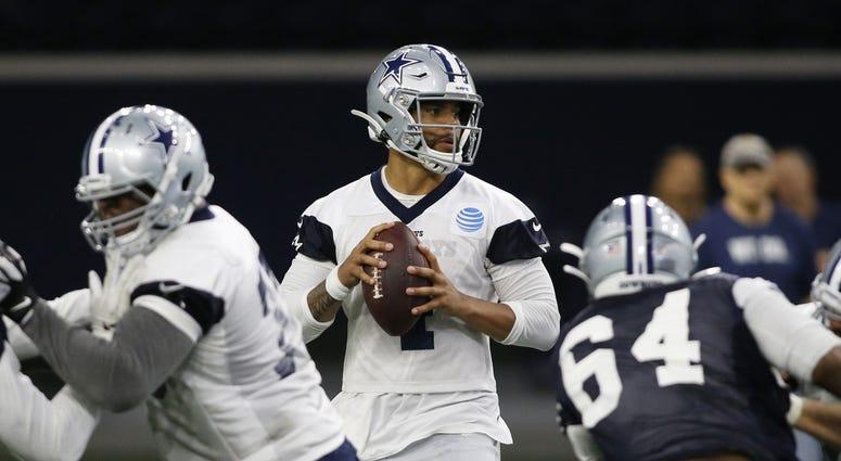 Jun 11, 2019; Frisco, TX, USA; Dallas Cowboys quarterback Dak Prescott (4) goes through a drill during practice at the Ford Center at the Star in Frisco