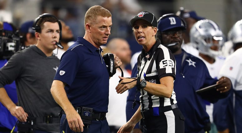 Dallas Cowboys head coach Jason Garrett talks with down judge Sarah Thomas