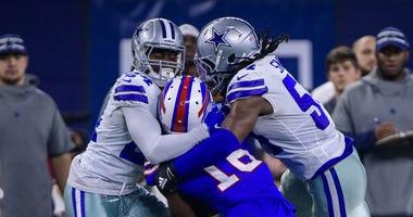 Dallas Cowboys cornerback Chidobe Awuzie (24) and linebacker Jaylon Smith (54)