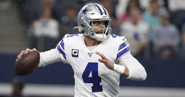 Dec 29, 2019; Arlington, Texas, USA; Dallas Cowboys quarterback Dak Prescott (4) rolls out in the first quarter against the Washington Redskins at AT&T Stadium