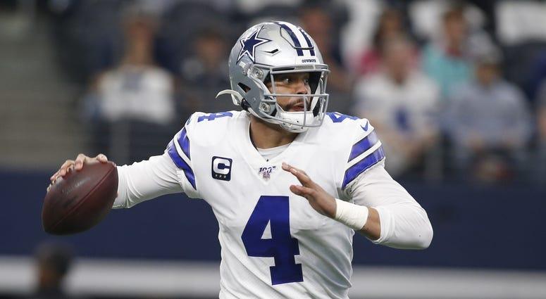 Dec 29, 2019; Arlington, Texas, USA; Dallas Cowboys quarterback Dak Prescott (4) rolls out in the first quarter against the Washington Redskins at AT&T Stadium