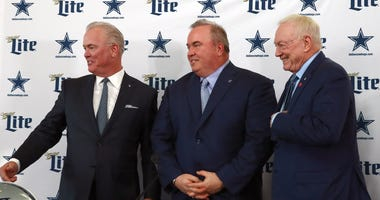 Dallas Cowboys head coach Mike McCarthy (center) with owner Jerry Jones (right) and executive vice president Stephen Jones