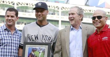 Texas Rangers former second baseman Michael Young (L), New York Yankees shortstop Derek Jeter (2), United States former president George W. Bush and Texas Rangers former catcher Ivan Rodriguez (