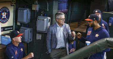 Houston Astros manager AJ Hinch (left) and general manager Jeff Luhnow
