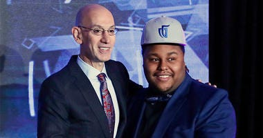 NBA Commissioner Adam Silver with the number 1 overall pick, Artreyo Boyd
