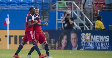 FC Dallas forward Roland Lamah (20) and forward Maximiliano Urruti (37)
